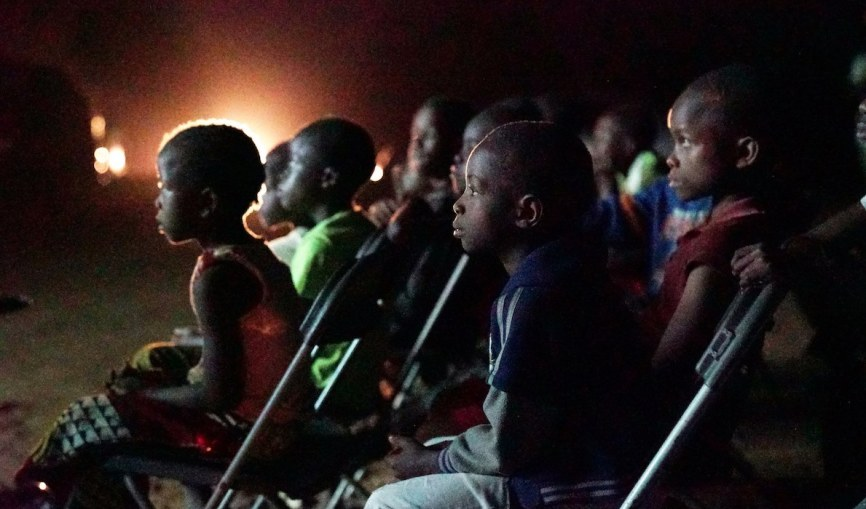 Children in Freetown watching films at the public viewing